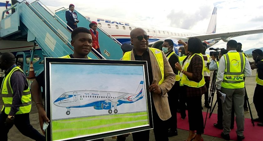 SAMUEL IGOH WITH HIS BEAUTIFUL PAINTING OF AIR PEACE 4th BRAND NEW EMBRAER 195-E2 AIRCRAFT